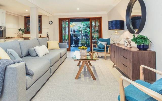 long lounge room| Selling your home Why property styling is your new best friend