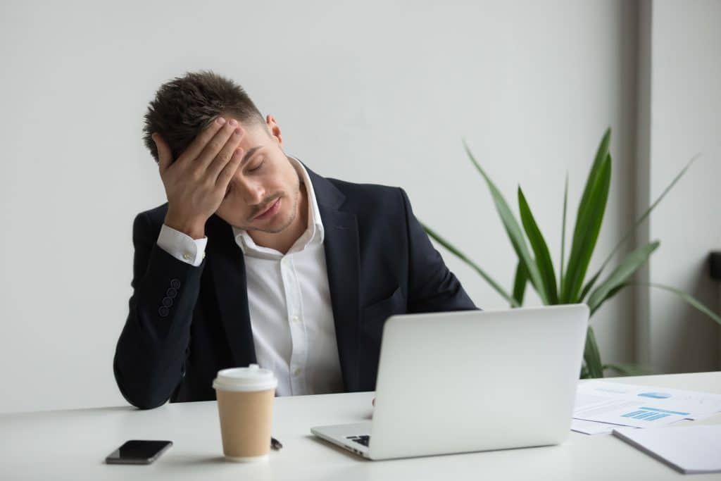 stressed man in laptop| Recovering from an investment gone bad
